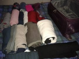 Clothes laid out, rolled and ready to pack